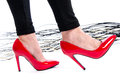 Woman wearing red high heel shoes isolated on white Royalty Free Stock Photo