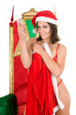 Woman wearing santa claus clothes and drinking Stock Photos