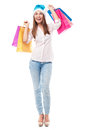 Woman wearing santa hat holding shopping bags young over white background Royalty Free Stock Images