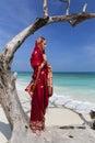 Woman wearing a sari on paradise beach. Royalty Free Stock Photo
