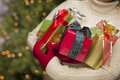 Woman Wearing Seasonal Red Mittens Holding Christmas Gifts Royalty Free Stock Images