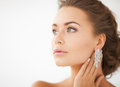 Woman wearing shiny diamond earrings close up of beautiful Royalty Free Stock Photos