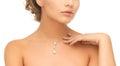 Woman wearing shiny diamond pendant wedding bridal jewelry and luxury concept beautiful necklace Royalty Free Stock Image