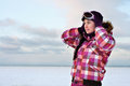 Woman wearing skiing suit posing outdoors Royalty Free Stock Photo
