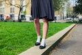 Woman wearing a skirt walking in park Royalty Free Stock Photo