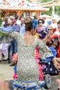 Woman wearing traditional Sevillana dresses and dancing a Sevillana at the Seville April Fair Royalty Free Stock Photo