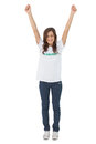 Woman wearing volunteer tshirt raising her arms on white background Stock Photo