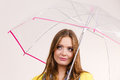 Woman wearing waterproof coat holding umbrella Royalty Free Stock Photo