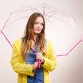 Woman wearing waterproof coat holding umbrella Royalty Free Stock Photo
