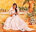 Woman wearing wedding dress at spa Stock Photo
