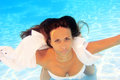 Woman wearing a white shirt swimming underwater Stock Photo
