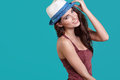 Woman wearing white straw hat on blue background Royalty Free Stock Photo