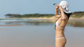 Woman wearing white string bikini. Royalty Free Stock Photo