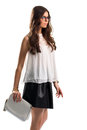 Woman wears blouse with insert white top and black skirt young model in glasses fashionable clothes from new collection Royalty Free Stock Photo