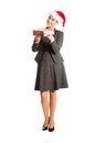 Woman weating Santa hat and holding a present Royalty Free Stock Photos