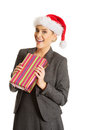 Woman weating Santa hat and holding a present Stock Images