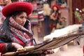Woman weaving a blanket made of alpaca wool in peru Royalty Free Stock Photos