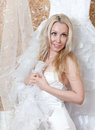 Woman with a wedding dress in hands the young dreams of Royalty Free Stock Images