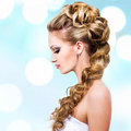 Woman with wedding hairstyle profile portrait Royalty Free Stock Images