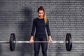 Woman with weight barbell doing deadlift exercise Royalty Free Stock Photo