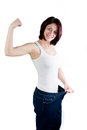 Woman weight loss attractive caucasian with big jeans on white background Royalty Free Stock Photography