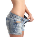 Woman weight loss diet concept closeup of a waist isolated on a white background Stock Images