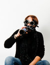 Woman with welding goggles drinking beer Royalty Free Stock Photo
