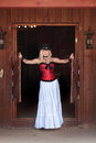 A woman in western saloon sexy red corset and long white standing the doorway of the old Royalty Free Stock Image