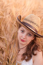 Woman in the wheat field farmer with crop Royalty Free Stock Photography