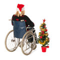 Woman in wheel chair with christmas tree blond wheelchair isolated over white background Royalty Free Stock Photography