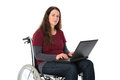 Woman in wheelchair with computer Royalty Free Stock Photo