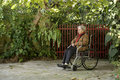 Woman in Wheelchair in Garden - Horizontal Royalty Free Stock Photos