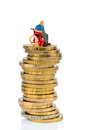 Woman in wheelchair on money stack symbol photo for care allowance health care costs Royalty Free Stock Photo