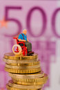 Woman in wheelchair on money stack symbol photo for disability care allowance and costs gesunheitswesen Royalty Free Stock Image