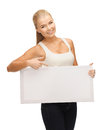 Woman with white blank board pointing her finger at Royalty Free Stock Photo