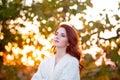 Woman in white blazer autumn time outdoor Stock Image
