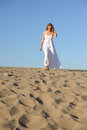 Woman in white dress beauty walking desert Royalty Free Stock Photos