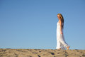 Woman in white dress beauty walking desert Royalty Free Stock Photo