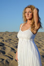 Woman in white dress beauty walking desert Royalty Free Stock Image