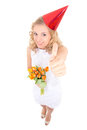 Woman in white dress and birthday cap with flowers thumbs up isolated on background Royalty Free Stock Images