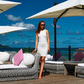 Woman in white dress near poolside jetty at seychelles Stock Photography
