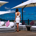 Woman in white dress near poolside jetty at seychelles Royalty Free Stock Photos