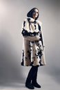 Woman in white mink spotty fur coat winter clothes fashion Stock Photos