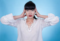 A woman in a white shirt posing with her hands on her head asian Royalty Free Stock Images