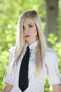 Woman in white shirt and tie portrait of young posing outdoor Stock Photography