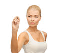 Woman in white shirt writing in the air portrait of Stock Photography