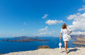 Woman with white umbrella  and sea Royalty Free Stock Photo