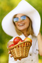 Woman wiht wicker basket holds red Royalty Free Stock Photo