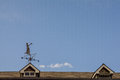 Woman in the wind nice weathervane on roof of an irish building Royalty Free Stock Images