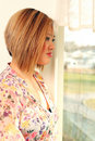 Woman at the window Stock Photo